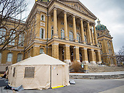 "16 MARCH 2020 - DES MOINES, IOWA: The health screening tent on the west side of the State Capitol in Des Moines. Because of numerous reports of Coronavirus in Iowa, the governor is suspending the legislative session for 30 days. It was scheduled to run until mid-April. Sunday night, the Governor announced that the state health department had recorded ""community spread"" in Des Moines. As a result the State Capitol instituted mitigation measures that included mandatory health screening for everyone going into the building, canceling group tours of the building, and closing the souvenir shop and snack bar.    PHOTO BY JACK KURTZ"