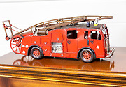 Old red model fire engine on display in house clearance auction sale room, UK