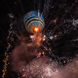 """The competing teams are playing traditional instruments and drums while brining their hot air balloon to the launching point to be eventually inflated by the fire of fuel-soaked """"torches"""".<br /> <br /> The fire balloons are made of paper, and designed by the participants. The candles, painting and even the fireworks are all made by hand. The making is quite an expensive affair, it often sums up to several thousand US Dollars. Parts of the funding is raised by the community and the rest by sponsorship from corporations.Together, the team is holding and rotating the balloon to show off the design. Some balloon makers focus on the design (painting or burmese script) whilst others adore them with candles called """"Sein Na Pan"""". <br /> <br /> Meantime, the crowd waits in astonishment for the firework to explode. Usually there is 50 kilo pack of<br /> firework ajusted to the hot air balloons. After around 50 meters of altitude the firework starts<br /> launching, pointing in all directions – even downwards.<br /> <br /> Observing the hot air balloon rising high, over the full moon still shooting firework is a magical moment. And sometimes it turns into a deadly one... About a half-dozen deaths in the past few years along with dozens of injuries to be specific. Almost every year an accident takes place when a hot air balloon catches fire and drops<br /> away while the firework remains shooting mercilessly."""