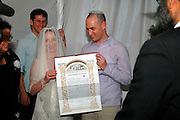 Holding up the ktuba at a Jewish wedding, Israel, May, 2006