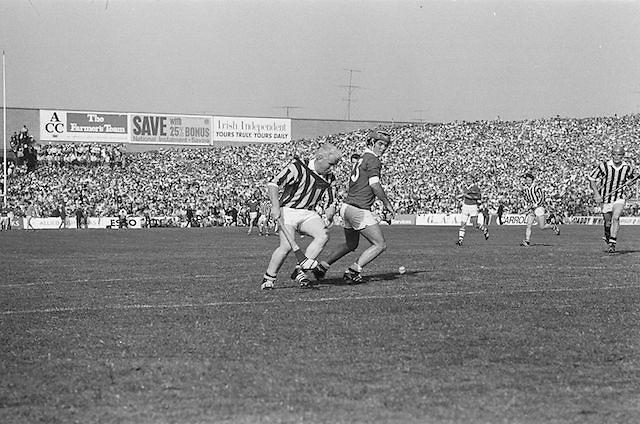 Kilkenny tries to get around Cork to retrieve the ball during the All Ireland Senior Hurling Final, Cork v Kilkenny in Croke Park on the 3rd September 1972. Kilkenny 3-24, Cork 5-11.
