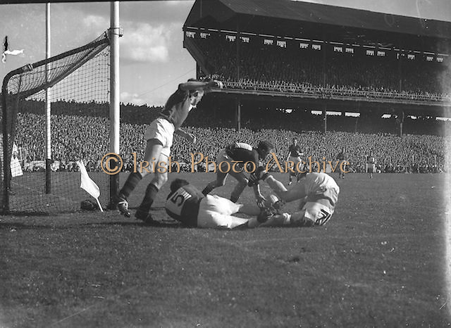 Group of players tackle for the ball during the All Ireland Senior Gaelic Football Final Down v. Offaly in Croke Park on the 24th September 1961. Down 3-6 Offaly 2-8.