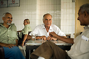 Regular customers sit and talk in the Indian Coffee House, Baba Kharak Singh Marg, New Delhi, India<br /> The Coffee House dates back almost fifty years, first in central Connaught Place, then Japnpath and now at the top of a rather shabby shopping centre. Still run by the Indian Coffee Workers Cooperative Society, it was a regular haunt for politicos in Delhi and It's clientelle is still well read and intellectual.