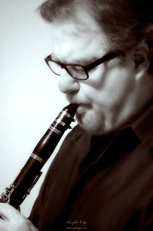 Larry Geiger on clarinet at Cedarvale Winery.