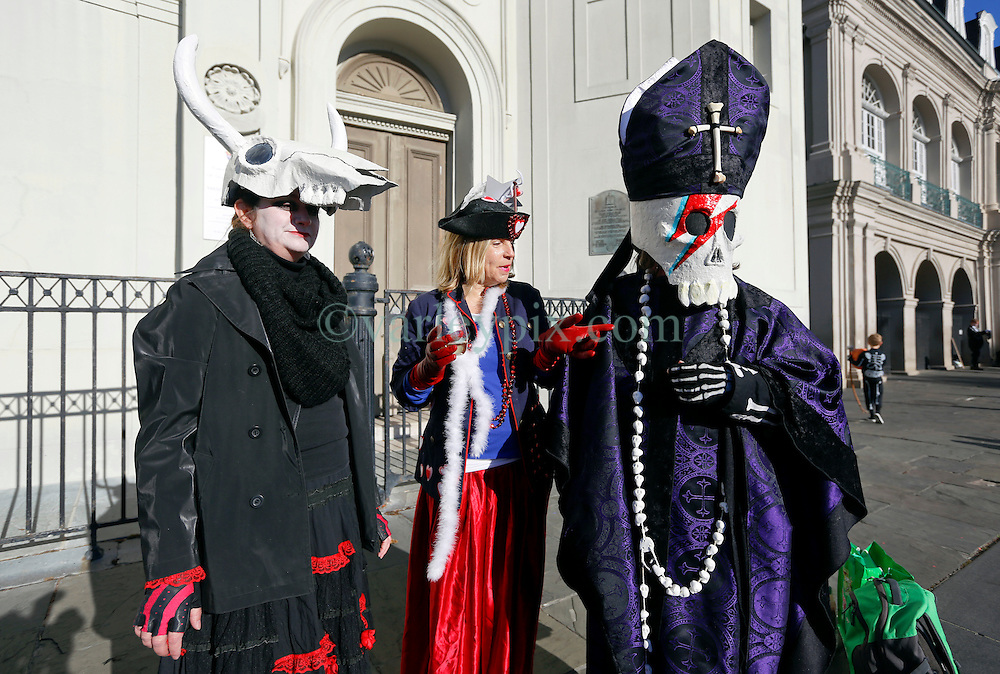 09 February 2016. New Orleans, Louisiana.<br /> Mardi Gras Day. Michelle, Wendy and Robert at jackson Square in the French Quarter.<br /> Photo©; Charlie Varley/varleypix.com