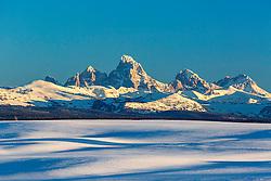 Snowfields and the Grand Tetons in Teton Valley near Ashton Idaho.