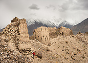 Yamchun Village and Zoroastrian Fort in the Wakhan Corridor, Tajikistan side, in the Pamir mountains. Afghanistan is on the other side of the Panj river.<br /> <br /> Tajikistan, a mountainous landlocked country in Central Asia. Afghanistan borders it to the south, Uzbekistan to the west, Kyrgyzstan to the north, and People's Republic of China to the east. Tajikistan also lies adjacent to Pakistan separated by the narrow Wakhan Corridor.<br /> Tajikistan became a republic of the Soviet Union in the 20th century, known as the Tajik Soviet Socialist Republic.<br /> It was the first of the Central Asian republic to gain independence in December 1991.