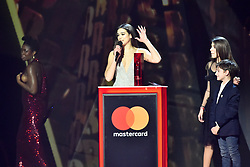 EDITORIAL USE ONLY.<br /><br />Clara Amfo walks off stage, as Dua Lipa, with her brother and sister, accepts the award for British Breakthrough on stage at the Brit Awards at the O2 Arena, London.