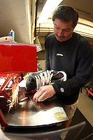 26 April 2007:  NHL Anaheim Ducks head equipment manager Mark O'Neill sharpens skates on a Blademaster machine as he prepares players skates for game 2 of the Western Conference Semi-Finals at the Honda Center in Anaheim, CA.