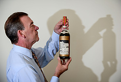Pictured: Bonham's Whisky expert Martin Green with a rare bottle of 60 year old Macallan  Valerio Adami whisky, which is expected to sell for close to 1 million GBP at auction in Edinburgh in October, making it the most expensive bottle of whisky ever sold.<br /> <br /> © Dave Johnston / EEm