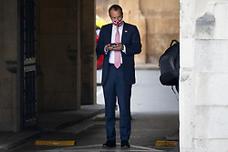 © Licensed to London News Pictures. 16/06/2021. London, UK. Health Secretary MATT HANCOCK uses his phone in The Houses of Parliament. Earlier today former chief advisor to number 10, Dominic Cummings, released a series of private WhatsApp conversations with Prime Minister Boris Johnson, in which the PM was critical of the health secretary.  Photo credit: George Cracknell Wright/LNP