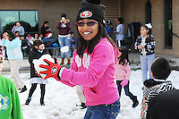 After school on Wednesday, several hundred area east Salinas children had a joyous afternoon with a full-fledged Christmas party, courtesy of the second annual Cesar Chavez Library Snow Day. The main attraction, of course, was a giant pile of fresh snow.