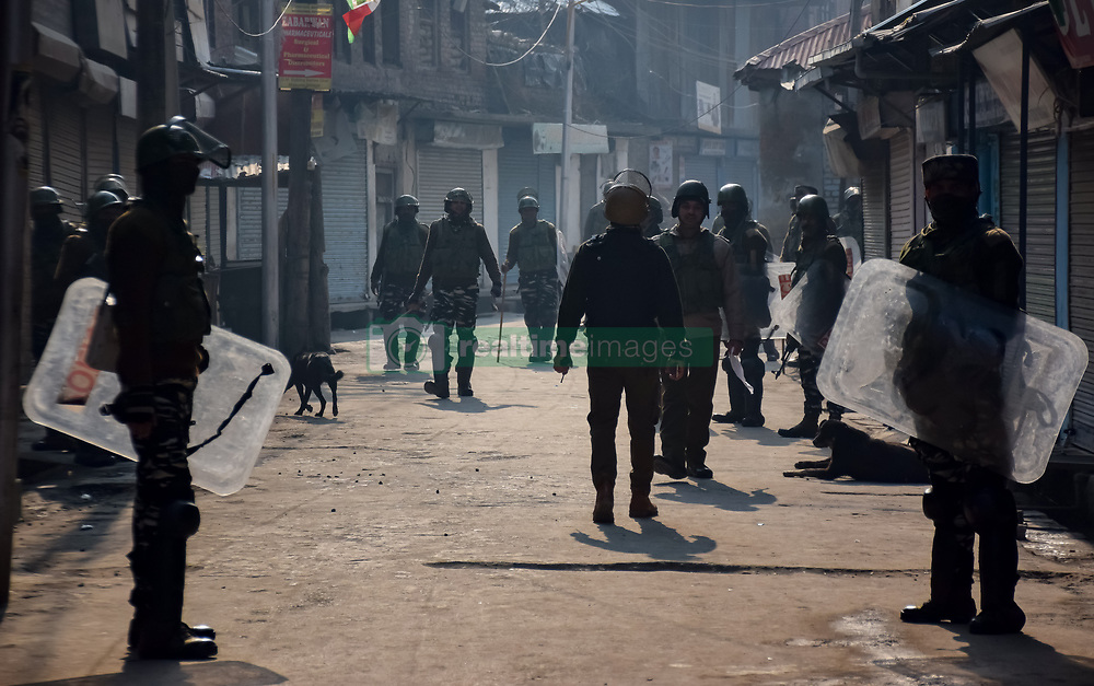 December 17, 2018 - Srinagar, Jammu & Kashmir, India - Indian army men are seen standing on guard during the restrictions in Srinagar..Authorities imposed restrictions to prevent a protest called by the Separatists groups against the killing of the seven civilians recently by Indian army men. (Credit Image: © Idrees Abbas/SOPA Images via ZUMA Wire)