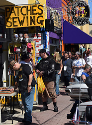 March 8, 2019 - Daytona, FL, United States - People shop for souvenirs on Main Street on March 8, 2019, the opening day of Bike Week in Daytona Beach, Florida. The 10-day event, which draws thousands of motorcycle riders and enthusiasts from around the world, is celebrating its 78th year. (Credit Image: © Paul Hennessy/NurPhoto via ZUMA Press)