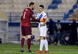 Jan Oblak of Slovenia and Andreas Bouchalakis of Greece after the football match between National teams of Greece and Slovenia in Final tournament of Group Stage of UEFA Nations League 2020, on November 18, 2020 in Georgios Kamaras Stadium, Athens, Greece. Photo by MATTHAIOS YORGOS / INTIME SPORTS / SPORTIDA