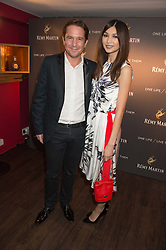 ERIC VALLAT CEO of Remy Martin and GEMMA CHAN at the launch of La Maison Remy Martin pop-up private members club at 19 Greek Street, Soho, London on 2nd November 2015.