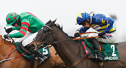 Dynamite Dollars, (right) ridden by Harry Cobden on the way to winning The randoxhealth.com Henry VIII Novices' Chase during day two of the Betfair Tingle Creek Christmas Festival at Sundown Park Racecourse, Sandown.