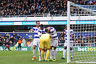 QPR players congratulate goalkeeper Alex Smithies of Queens Park Rangers after he saves an Aston Villa penalty in the first half taken by Jonathan Kodjia . EFL Skybet championship match, Queens Park Rangers v Aston Villa at Loftus Road Stadium in London on Sunday 18th December 2016.<br /> pic by Steffan Bowen, Andrew Orchard sports photography.