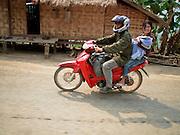 Mar. 13, 2009 -- VANG VIENG, LAOS: A family on their motor scooter along Highway 13 between Vang Vieng and Luang Prabang, Laos.  Photo by Jack Kurtz