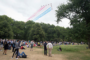 The Red Arrows fly over Green Park on the 100th anniversary of the Royal Air Force (RAF)representing Britain's air defence history flew over central London, on 10th July 2018, in London, England.