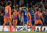 Football - 2016 / 2017 Premier League - Chelsea vs. Manchester City<br /> <br /> Cesc Fabregas of Chelsea holds his head in his hands after his deflected shot hits the cross bar at Stamford Bridge.<br /> <br /> COLORSPORT/DANIEL BEARHAM
