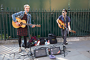 Young men busking on the street in Westminster, London, England, United Kingdom.