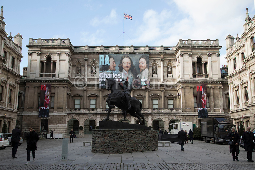 Exterior of the Royal Academy in London, England, United Kingdom. The Royal Academy of Arts or RA is an art institution based in Burlington House on Piccadilly. It has a unique position as an independent, privately funded institution led by eminent artists and architects; its purpose is to promote the creation, enjoyment and appreciation of the visual arts through exhibitions.