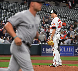 May 30, 2017 - Baltimore, MD, USA - The Baltimore Orioles' Chris Tillman, right, reacts as the New York Yankees' iMatt Holliday, left, rounds the bases after his second home run of the game in the third inning at Oriole Park at Camden Yards in Baltimore on Tuesday, May 20, 2017. The Yankees won, 8-3. (Credit Image: © Kenneth K. Lam/TNS via ZUMA Wire)