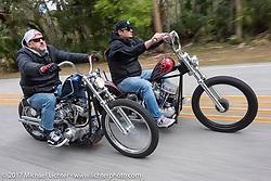 "Bo Hatzoge (L) riding an Eric Stein built 1974 custom Harley-Davidson Shovelhead alongside Chris Wade riding his custom 1953 Harley-Davidson Panhead ""Supafly"" through Tomoka State Park during Daytona Beach Bike Week. FL. USA. Tuesday, March 14, 2017. Photography ©2017 Michael Lichter."