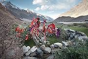 An Muslim Ismaili shrine full of colorful flags, near Baba Tangi village. Driving up from Ishkashim town to Sarhad village, the end of the road in the Wakhan corridor, Afghanistan.