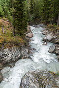 rapid flowing water as seen from the Wilde Wasser Weg (Wild water way) trail, Stubaital, Tyrol, Austria