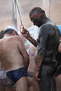 Israel, Dead Sea, tourists cover themselves in therapeutic mud in order to benefit from claimed skin care properties of this mud.