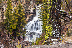 Undine Falls, in North Yellowstone near Mammoth.  One of the many easily accessed waterfalls of Yellowstone. Yellowstone is a marvel, full of waterfalls and other amazing sights. Undine Falls is about 60 feet tall.
