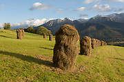 Traditional Polish haystacks on agricultural land that is overlooked by the Tatra mountains, on 16th September 2019, in Koscielisko, Zakopane, Malopolska, Poland.