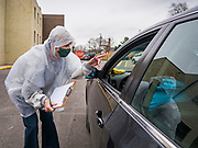 06 APRIL 2020 - DES MOINES, IOWA: during a drive through emergency food distribution at First DSM Church. On Monday, 06 April, Iowa reported 946 confirmed cases of the Novel Coronavirus (SARS-CoV-2) and COVID-19. There have been 25 deaths attributed to COVID-19 in Iowa. Most non-essential businesses are closed until 30 April. Well over 100,000 Iowans filed first time claims for unemployment in the last three weeks, more than applied during the peak of the Great Recession of 2008. Local food banks have seen an equal spike in people seeking nutritional assistance. First DSM Church has increased their food pantry from one day weekly to three time days per week. Hundreds of people lined up Monday to get a box of food and one roll of toilet paper at the church's drive through pantry.           PHOTO BY JACK KURTZ