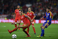 Gareth Bale of Wales goes past Ivan Lorenzo of Andorra. Wales v Andorra, Euro 2016 qualifying match at the Cardiff city stadium  in Cardiff, South Wales  on Tuesday 13th October 2015. <br /> pic by  Andrew Orchard