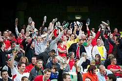 DUBLIN, REPUBLIC OF IRELAND - Friday, May 27, 2011: Wales supporters hold their shoes in the air as they celebrate against Northern Ireland during the Carling Nations Cup match at the Aviva Stadium (Lansdowne Road). (Photo by David Rawcliffe/Propaganda)