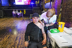 © Licensed to London News Pictures. 08/08/2021.London,UK, Baga Chipz Drag Queen receives the first dose of the Pfizer/BioNTech vaccine at a pop-up vaccination at Heaven night club in central London.  Photo credit: Ioannis Alexopoulos/LNP
