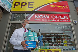 ©Licensed to London News Pictures 15/07/2020     <br /> Chislehurst, UK. Local business man Paul Britt stocking up on protective masks. Business man and director Raymond Smith has opened a PPE shop on Chislehurst High Street in Chislehurst, South East London. Bringing wholesale prices to the public with no online waiting time its believed to be the first high street shop of its kind in the UK helping in the fight against coronavirus. Photo credit: Grant Falvey/LNP