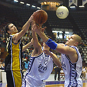 EURULEAGUE<br />EFES PILSEN - A.E.K.<br />A.E.K.'s Antic Pero (L) with Golemac Jurica, Kambala Kaspars (R) during their Abdi Ipekci Sport Hall in ISTANBUL at TURKEY.<br />Photo by AYKUT AKICI/TurkSporFoto