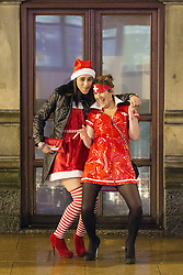 """© Licensed to London News Pictures . 15/12/2012 . Manchester , UK . Women dressed in fancy dress as Santa Claus and a nurse . Revellers enjoy a wet but busy night out on one of the last weekends before Christmas , a traditionally busy time when office parties and clubbers decent on bars and clubs , often known as """" Mad Friday """" . Photo credit : Joel Goodman/LNP"""