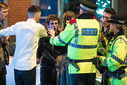 """© Licensed to London News Pictures . 23/12/2017. Manchester, UK. Police intervene to break up a fight outside the Printworks . Revellers out in Manchester City Centre overnight during """" Mad Friday """" , named for being one of the busiest nights of the year for the emergency services in the UK . Photo credit: Joel Goodman/LNP"""