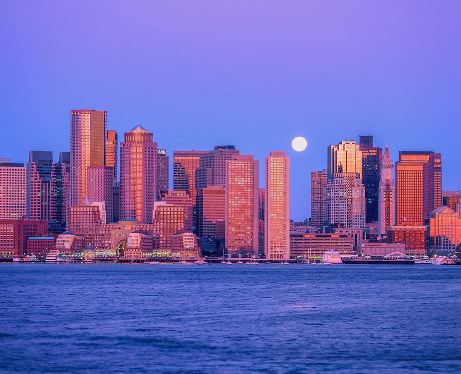 Skyline of Boston Harbor setting moon and first light, Boston, MA