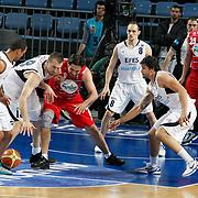 Efes Pilsen's Nikola VUJCIC (2ndL), Igor RAKOCEVIC (B), Cenk AKYOL (2ndR) and Pinar Karsiyaka's Jovo STANOJEVIC (3ndL), Sean MARSHALL (R) during their Turkish Basketball Legague Play-Off qualifying first match Efes Pilsen between Pinar Karsiyaka at the Sinan Erdem Arena in Istanbul Turkey on Wednesday 11 May 2011. Photo by TURKPIX