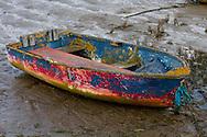 Abandoned dinghy on mud
