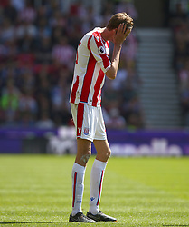 Stoke City's Peter Crouch appears dejected during the Premier League match at the bet365 Stadium, Stoke.