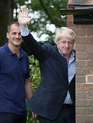 © Licensed to London News Pictures. 26/06/2016. Oxfordshire, UK. Boris Johnson waves to reporters as he walks with Jake Berry MP at his home in Oxfordshire. Prime Minister David Cameron his holding a cabinet meeting tomorrow after announcing his resignation on Friday. The United Kingdom has voted to leave the EU in an historic referendum.  Photo credit: Peter Macdiarmid/LNP