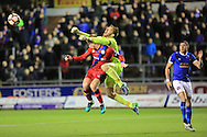 Mark Gillespie punches clear under pressure from Callum Camps during the The FA Cup match between Carlisle United and Rochdale at Brunton Park, Carlisle, England on 3 December 2016. Photo by Daniel Youngs.