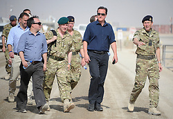 © Licensed to London News Pictures. 17/01/12. FILE PICTURE The MOD has announced Up to 2,900 Army, 1,000 RAF and 300 Royal Navy staff to be made redundant in latest UK defence cuts.04/07/2011.Camp Bastion, Afghanistan. British Prime Minister David Cameron visits ISAF personnel in Camp Bastion, Afghanistan today (4 Jul 11).  The PM met with British and US troops and addressed them at a fourth of July service held in Camp Leatherneck, which is the US contingent within Bastion. See special instructions. Mandatory Photo credit : Sergeant Alison Baskerville/LNP