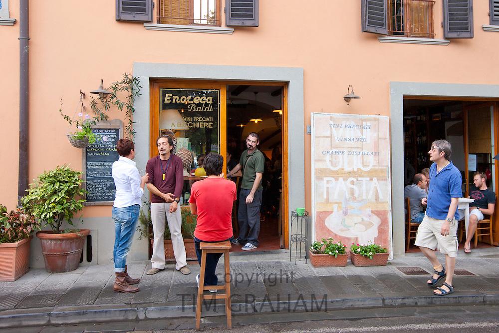 Diners at restaurant Enoteca Baldi in Piazza Bucciarelli, Panzano-in-Chianti, Tuscany, Italy